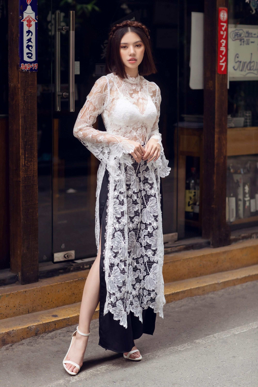 Duyên dáng và năng động khi diện áo dài như Jolie Nguyễn - Ảnh 4.