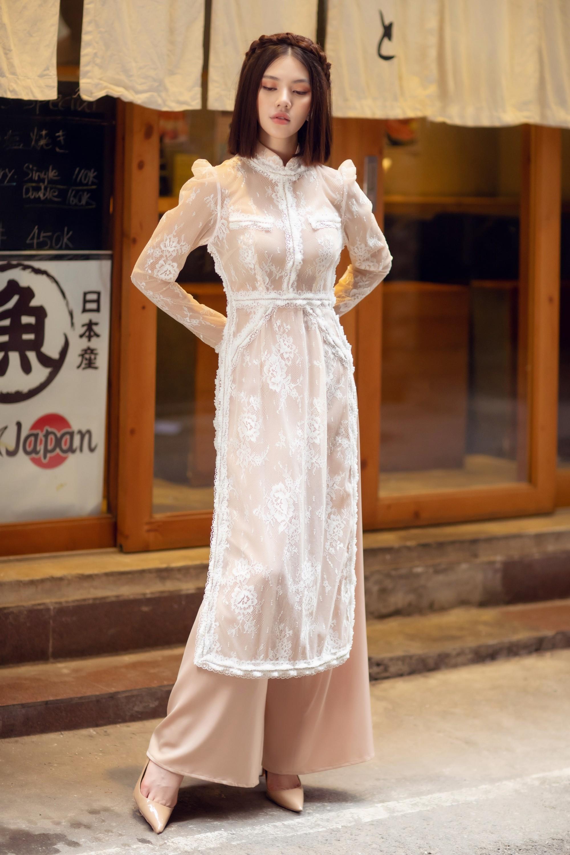 Duyên dáng và năng động khi diện áo dài như Jolie Nguyễn - Ảnh 8.