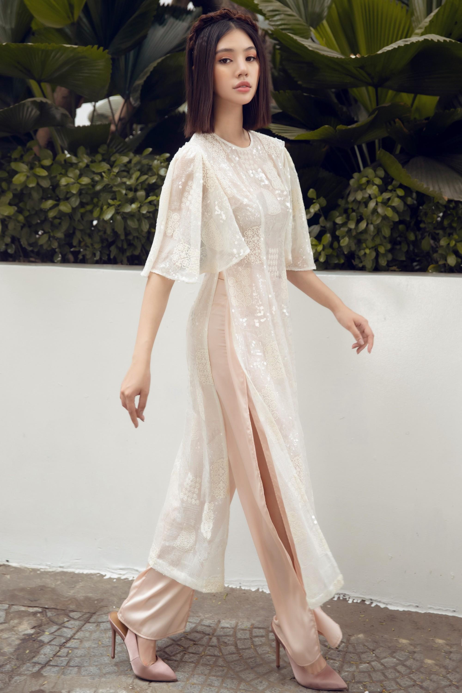 Duyên dáng và năng động khi diện áo dài như Jolie Nguyễn - Ảnh 10.