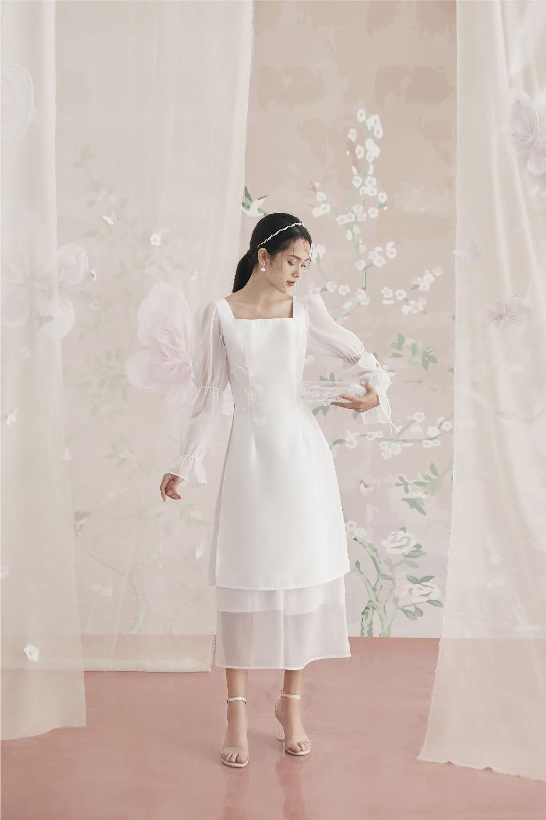 Diện đẹp đón Tết Canh Tý với mẫu áo dài họa tiết lạ mắt - Ảnh 3.
