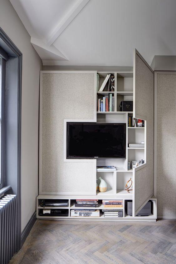 Hệ tủ đứng kết hợp kệ TV và giá để sách. Sẽ thật bất tiện nếu đây là tủ thường và tách rời các chức năng đúng không nào ?