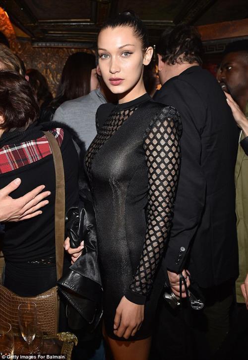 Phong cách thời trang tạo nên thương hiệu của chị em nhà Hadid và Kim - Ảnh 10.