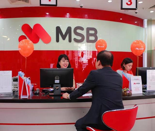 Chủ kinh doanh tiết kiệm tới 80 triệu đồng/năm khi giao dịch qua ngân hàng - Ảnh 1.