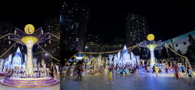 Người dân Thủ đô hào hứng check-in với cây đèn lồng Hoa Đăng lớn nhất Việt Nam - Ảnh 1.