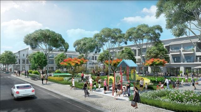 Khu công viên cây xanh có đường dạo bộ xanh mát bao quanh khu nhà liền kề hiện đại.