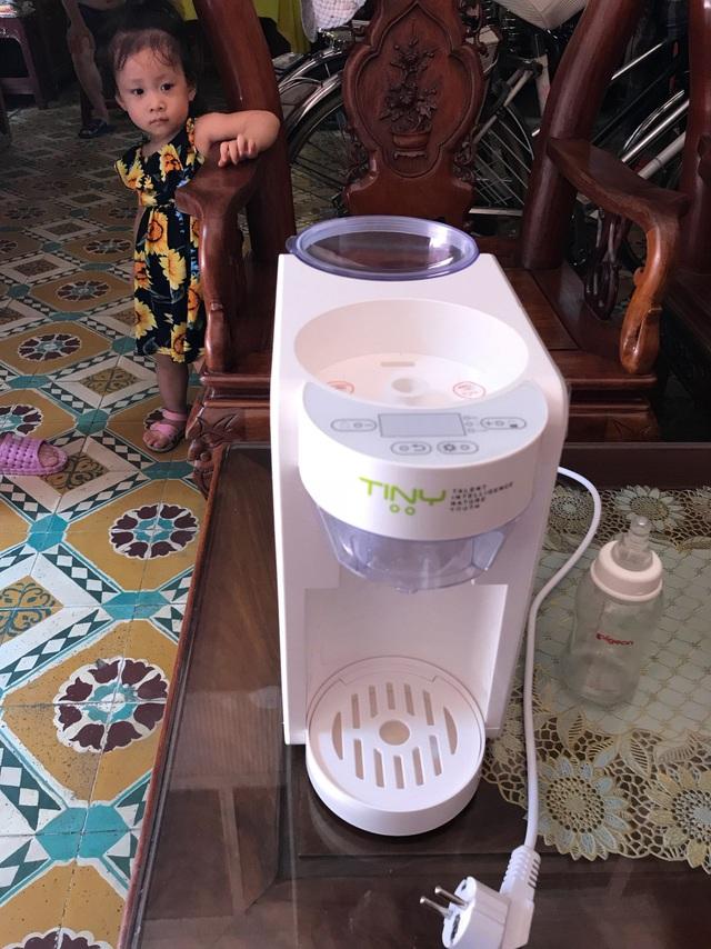 Máy pha sữa bột Tiny Baby Nhật Bản, người bạn không thể thiếu của các mẹ bỉm sữa - Ảnh 1.