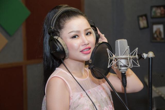 Janny Thủy Trần kết hợp cùng nhạc sĩ Tăng Nhật Tuệ ra mắt MV Tết - Ảnh 1.
