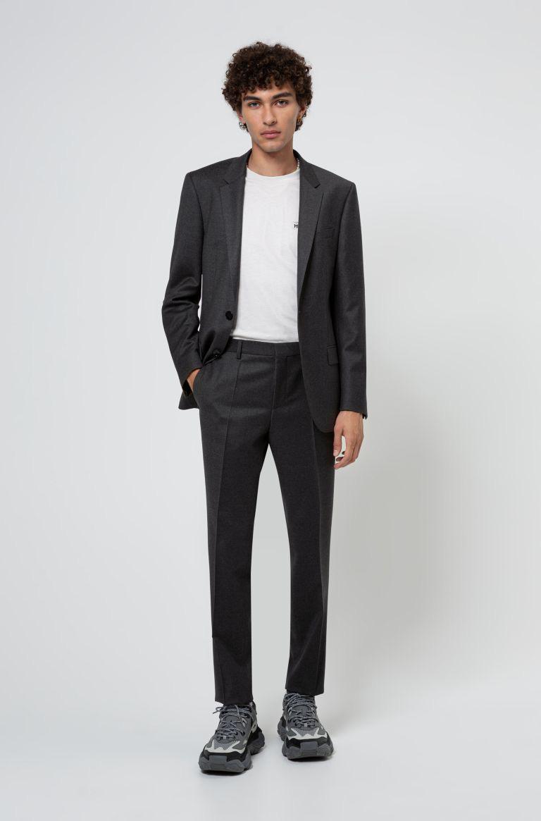 Ném suit vào máy giặt, gấp gọn bỏ vali: Loạt phục trang ứng dụng thú vị từ HUGO ghi điểm mạnh mẽ với phong cách quý ông - Ảnh 5.