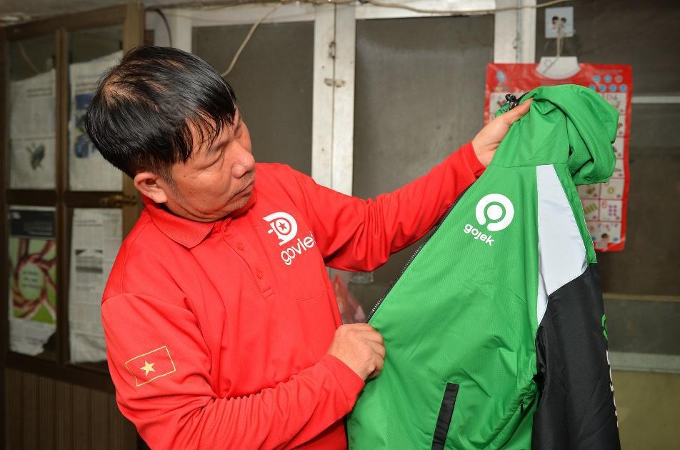 Đồng phục mới cho những tài xế đặc biệt trước ngày GoViet hợp nhất với Gojek - Ảnh 1.