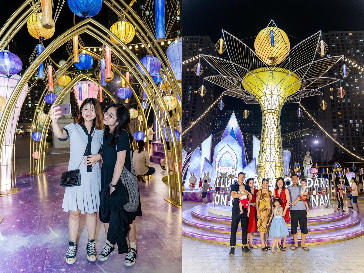 Người dân Thủ đô hào hứng check-in với cây đèn lồng Hoa Đăng lớn nhất Việt Nam - Ảnh 2.