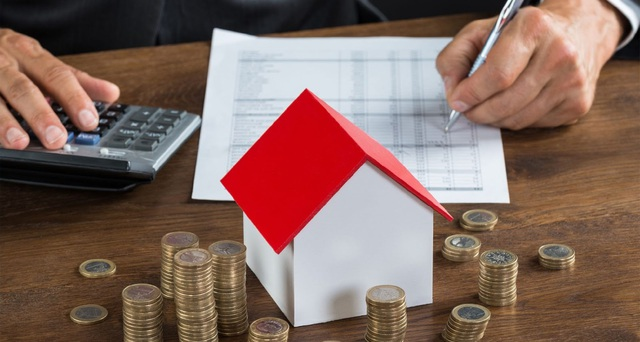 Lãi suất ngân hàng giảm, có nên chớp thời cơ mua nhà? - Ảnh 1.