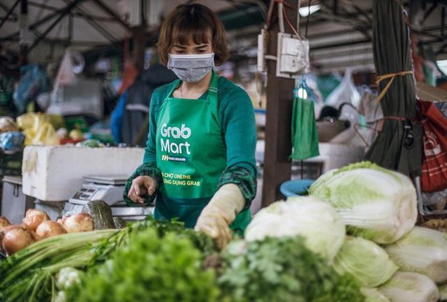 Hà Nội: Chủ sạp chợ Thành Công háo hức bán hàng Tết qua GrabMart - Ảnh 1.