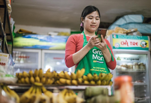 Hà Nội: Chủ sạp chợ Thành Công háo hức bán hàng Tết qua GrabMart - Ảnh 2.