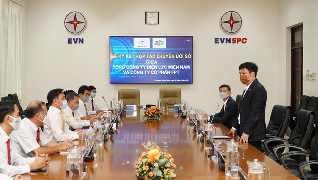 FPT cùng EVNSPC ký kết thoả thuận hợp tác về chuyển đổi số - Ảnh 1.