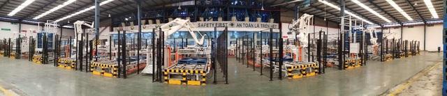 Doanh nghiệp việt đẩy mạnh ứng dụng robot đóng bao tự động vào quy trình sản xuất - Ảnh 2.