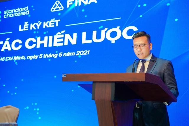 FINA hợp tác chiến lược  toàn diện cùng Standard Chartered Việt Nam - Ảnh 1.