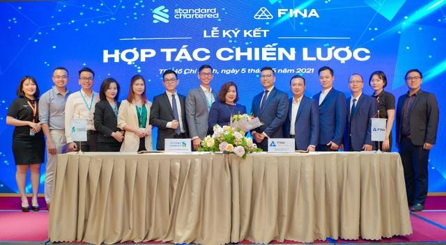 FINA hợp tác chiến lược  toàn diện cùng Standard Chartered Việt Nam - Ảnh 2.