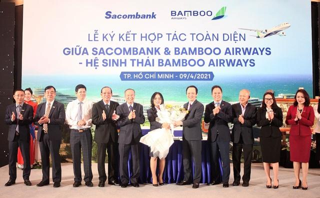 Chung tầm nhìn tiên phong chuyển đổi số, Bamboo Airways và Sacombank hợp tác toàn diện - Ảnh 2.