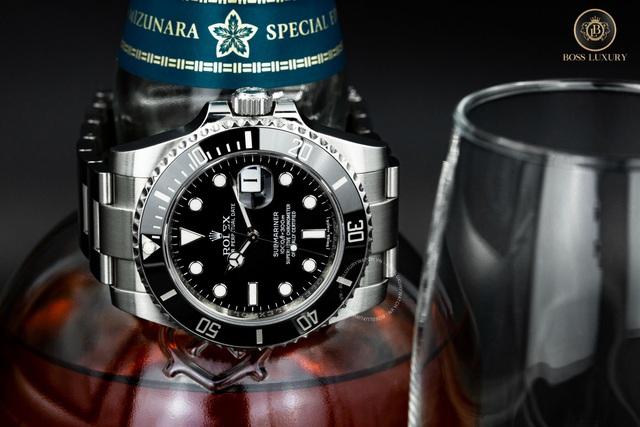 Cùng Boss Luxury phân biệt đồng hồ Rolex Submariner thật - giả - Ảnh 1.