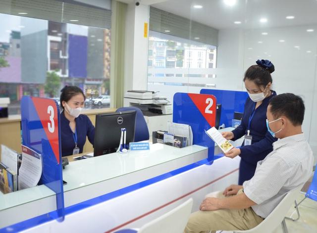 Ngân hàng hỗ trợ doanh nghiệp mùa dịch bệnh Covid-19 - Ảnh 1.